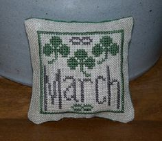 St Patrick's Day / March cross stitch mini pillow or pin keep. Pattern is part of a design by From the Heart- NeedleArt by Wendy. I added the border.