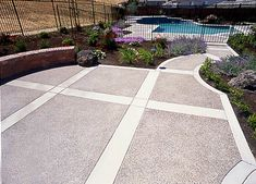 exposed aggregate patio with border | Bi-Level Exposed Aggregate Patio and Pool Deck Accented with Flagstone ...