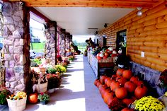 You can't miss the big red roof at Troyer's Country Market. Such a beautiful display outside in this photo!