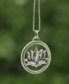 Sterling silver spiritual lotus flower necklace, handmade in Thailand. Lotus jewelry available at BuddhaGroove.com.