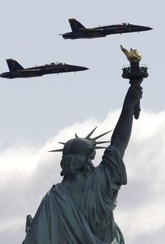 Two US Navy Blue Angels jets are seen from Liberty State Park as they flew over the Statue of Liberty. The two F/A-18 Hornet Fighter Jets were on a practice run for a potential flight course for this year's Fleet Week celebration in May.