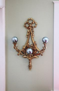 Vintage Glam:  Large Gold Syroco Wall Sconce - Hollywood Regency Style. $30.00, via Etsy.