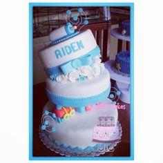 Whimsical topsy turvy baptismal cake by majesto cake studio