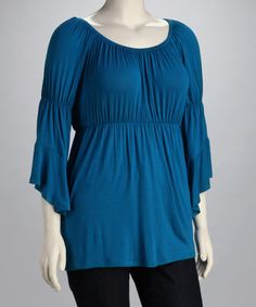 Classic color and fluttering sleeves make this top an elegant option. The stretch design moves with the body, guaranteeing curve-friendly comfort in addition to on-trend style.94% rayon / 6% spandexMachine wash; dry flatMade in the USA