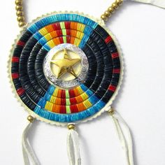 Quilled Star Medallion by Beyond Buckskin Boutique - I would wear this a lot. I'd find reasons to. It's a fantastic piece of art by Lonna Jackson (Spirit Lake Dakota/Turtle Mountain Chippewa. What would you style it with?