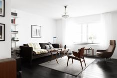 A Swedish home with black floors and a mid-century touch
