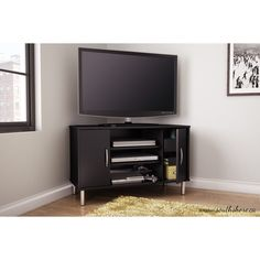 "The South Shore Renta 38.5"" Pure Black Corner TV Stand - 4507690 has a perfect combination of closed and open storage spaces. Simple lines and metallic touches, for a contemporary style. 3 open storage spaces, separated by 2 adjustable shelves, and 2"