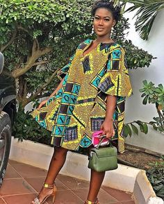 Image may contain: 1 person, standing, shoes and outdoor Short African Dresses, Latest African Fashion Dresses, African Print Dresses, African Print Fashion, Africa Fashion, African Traditional Dresses, African Attire, African Women, Mode Style