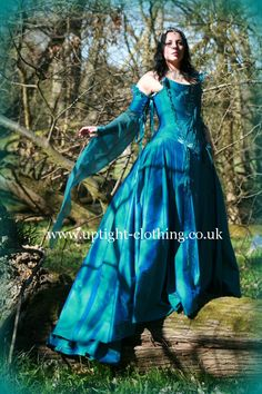 This is fairytale gown consists of a 18th century fronted corset in turquoise silk, allowing space for a beautiful swathe of embroidered decoration, of ruched chiffon, crystals and embroidered Dragonflies....with the usual waist reducing cut of corset Uptight is renound for...best of both worlds!The sleeves are separate, with dragonflies around the top, flowing into a delicate chiffon medieval sleeve. Turquoise Wedding Dresses, Peacock Wedding Colors, Fabulous Dresses, Beautiful Gowns, Fairytale Gown, Fantasy Clothes, Gothic Wedding, Designer Gowns, Alternative Fashion