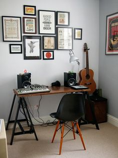 {wall color, Eames chair, black collection of frames}