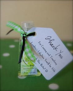 "Hand Sanitizer Favors for a Baby Shower :: The tag reads ""Thank you for coming and touching life, now  you'll be able to touch her baby!"""