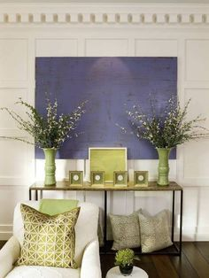 White crisp walls with purple and green accents for the sitting room off the hallway.