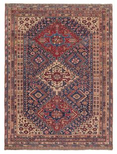 QASHQAI, Southwest Persian, 4ft 4in x 6ft 0in, 3rd Quarter, 19th Century. This collectible Persian nomadic rug combines an abundance of individualized detail with an overarching visual harmony. The result is a composition that is dazzlingly complex yet entirely cohesive.
