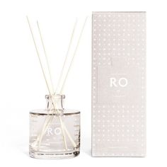 Skandinavisk Ro (Tranquility) Scented Diffuser: RO [RO], peace, calm and tranquility from the kingdoms of Denmark, Norway and Sweden. A serene blend of fresh grass and crumpled leaves, ambered woods and hidden blankets in the dunes. Room diffuser by Skandinavisk.