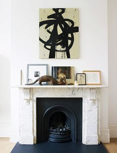 black and white abstract artwork and marble fireplace //  mantel decor