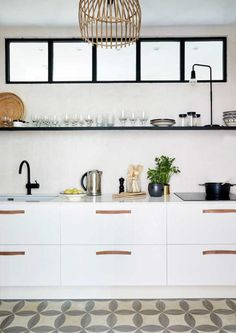 The kitchen too is light and simple. A truly Scandinavian interior is very liveable and functional as is evident in this modern kitchen space, complete with ample storage and open shelves.