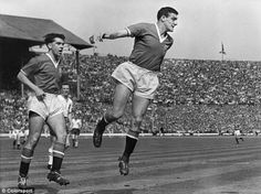 Centre back Bill Foulkes heads the ball away from danger during the 1958 FA Cup Final defeat to Bolton