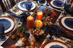 """The Tablescaper: Fall Party Contrast of navy blue dinnerware against rust-colored chargers makes the entire table """"Pop""""!"""