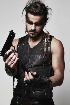 Skull Rocker Bag Fury Road Gloves A bunch of jewelry Tony Montemarano of Mursic Shot by Cindil Ashley Photography Ryder Makeup Labs Post Apocalyptic Costume, Post Apocalyptic Fashion, Apocalypse Fashion, Post Apocalypse, Mode Punk, Costume Carnaval, Tribute, Male Makeup, Man Fashion