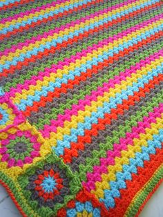 the granny stripes and squares colorful blanket por handmadebyria
