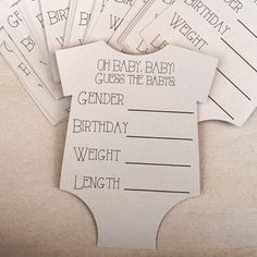 Super cute guess the baby stats cards cut out in the shape of a onesies. Made with high quality ink & card stock paper These cards are a great game for