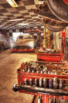 Cool Garage with garage tools and cars.