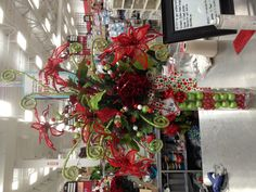 Christmas Cheer Christmas Entryway Floral Arrangement Designed by Christian Rebollo 2012 for store 2870