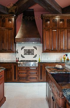 Make Copper the centerpiece of your kitchen like this customer did with a Copper Range Hood and Copper Farmhouse Apron Scroll Design Kitchen Sink from Premier Copper Products.