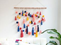 Pom pom fetishists: we offer you this DIY wall hanging. May it appease your wool-laden fantasies.