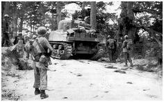 Men and a Sherman tank of the 382nd Infantry Regiment, US 96th Division on the Ginowan Road, Okinawa, Japan, Apr-Jun 1945  Meanwhile, the 77th Infantry Division assaulted Ie Shima, a small island off the western end of the peninsula, on April 16. In addition to conventional hazards, the 77th Infantry Division encountered kamikaze attacks, and even Japanese women armed with spears. There was heavy fighting before Ie Shima was declared secured on April 21 and became another air base for…