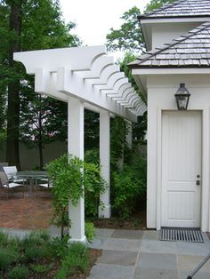 Pergola for blocking side yard view plant live fence next to it and greenery growing over pergola with a cool arch in opening would be so charming