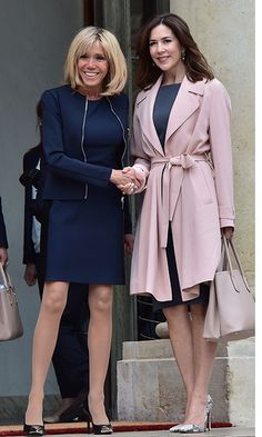 Crown Princess Mary of Denmark wore the perfect pink duster coat as she met with French First Lady Brigitte Macron at the Élysée Palace in Paris.