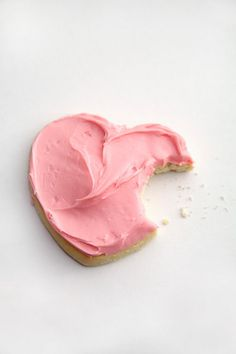 delicious heart shaped pink frosting cookie