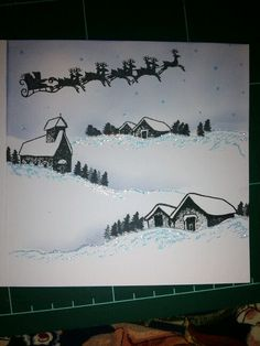 Christmas snow scene with father christmas and reindeer. Stamped with card-io stamps.