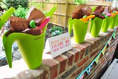 worm-themed bday party, fun loot bags in watering cans | Young House Love