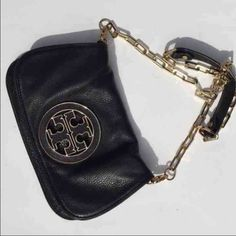 Authentic Tory Burch Amanda Purse Long side purse. 100% authentic, comes with dust bag, like new condition, black and gold Tory Burch Bags Crossbody Bags