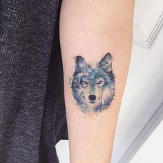 Water color wolf tattoo by Adrian Bascur