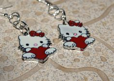 Hello Kitty Red and White Heart Enamel by Jewelry Shop, Jewelry Design, Jewellery, Unique Jewelry, Female Heroines, Cat Valentine, Beautiful Hands, Hello Kitty, Red And White