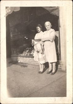Two women Standing In Front of a Shop 1940's by foundphotogallery