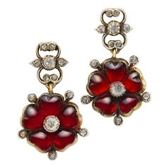 a pair of victorian garnet and diamond flower earrings, the flower motifs centered with an old-cut diamond surrounded by cabochon garnet petals interspersed with rose-cut diamonds, all set in silver to a yellow gold mount with peg and scroll fittings Victorian Jewelry, Antique Jewelry, Vintage Jewelry, Garnet Jewelry, Garnet Earrings, Diamond Earrings, Vintage Accessories, Jewelry Accessories, Antique Earrings