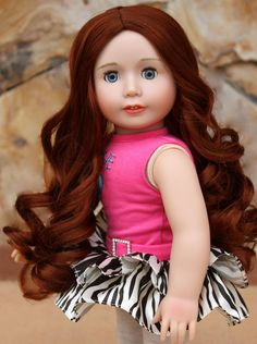 www.harmonyclubdolls.com Our 18 Inch Red head doll, Lyric, is the same size as American Girl Dolls. She has a soft body, poseable limbs and open and close eyes. She has wigged hair made from premium quality kanekalon.