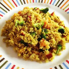 Vegatarian meal: quinoa, broccoli, red peppers and carrots with turmeric and curry powder.