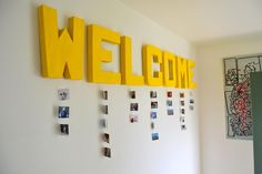 cardboard letters hanging photo display. Cute for a kids room.