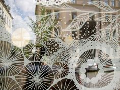 Liquid chalk and paper window art at La Robe Marie