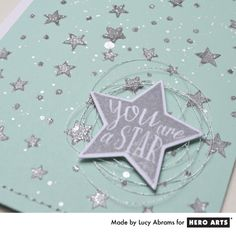 Stencil layering: Lucy shows how to add layers of ink, embossing paste and glitter to a stencil to create a sparkly background