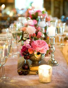 banquet style tables, vintage books and pink flowers