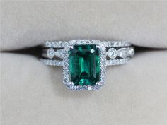Beautiful and unique emerald engagement ring. Three Rings 2.33ct Emerald Ring with Two Diamond by AbbyandWills, $794.00