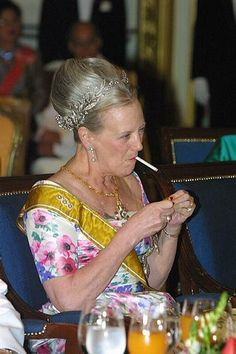 Queen Margrethe of Denmark...yep, she smokes and she has told every body to bud out!!!
