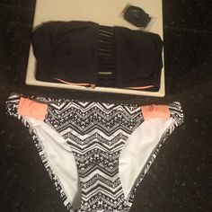 2 piece bathing suit, NWOT, includes strap Two piece bathing suit, top strapless but includes detachable strap. Never worn, NWOT. Bottom size Medium, top size XS Swim Bikinis