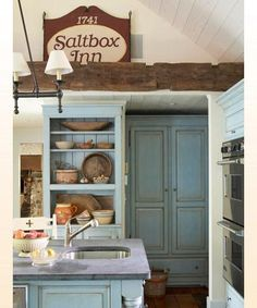 rustic blue kitchen cabinets slate counters...I just refinished my kitchen cabinets 2 years ago, but this makes me want to do them again in this color
